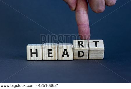Heart Or Head Symbol. Doctor Turns Wooden Cubes And Changes The Word 'head' To 'heart'. Beautiful Gr