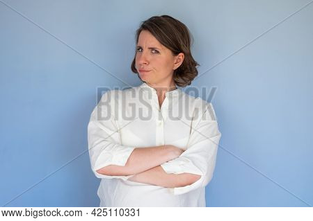 Caucasian Woman With Mistrust Frown Confused Facial Emotion.
