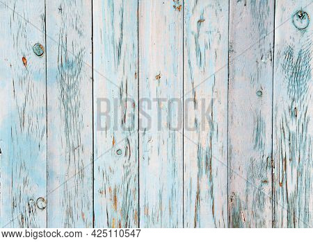 Texture of vintage wood boards with cracked paint of cyan and blue color. Horizontal retro background with old wooden planks