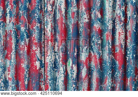 Colorful Motley Peeled Off Red And Blue Paint Layers On Corrugated Zinc Coated Steel Sheet Texture