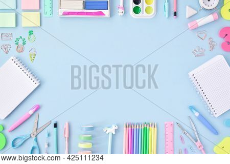 A Frame Of School Supplies In Pastel Colors On A Light Blue Background, Space For Text. Office Suppl