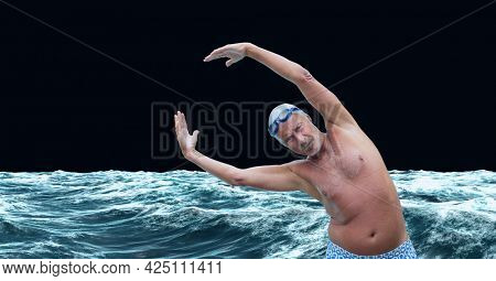 Composition of male swimmer raising hands on black background. sport and competition concept digitally generated image.