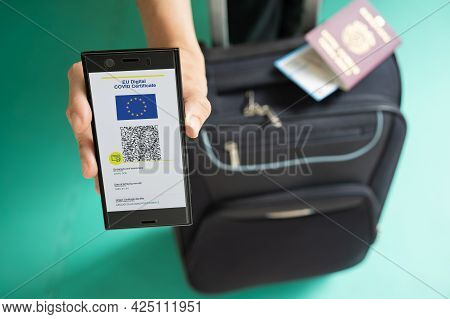 Woman Showing On Smartphone Eu Digital Covid Certificate With Quad Code. With Passport, Boarding Pas
