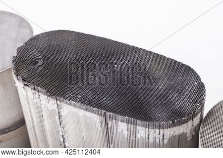 Close-up View On A Burnt Out Oval Ceramic Catalysts Containing Platinum, Palladium And Rhodium On A