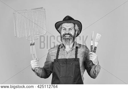 Medium Rare. Tools Roasting Meat. Man In Apron Hold Barbecue Grill. Farmer With Bbq Equipment. Cooki