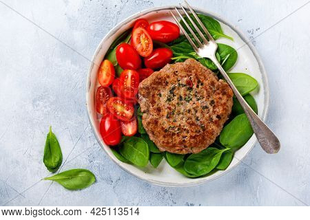 Grilled Steak Of Beef With Cherry Tomatoes And Spinach, Garlic, Seasonings, Peppers And Onions. Ples