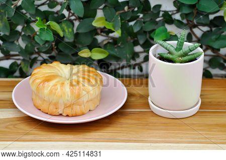 Bread , Bun Or Cream Bread Or Butter Bread And Sansevieria Boncellensis