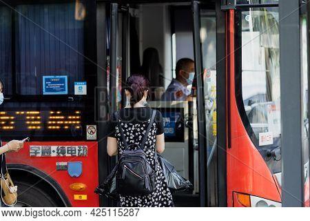 Huzhou, China June 22, 2021: Passenger Waiting Public Transport At Bus Stop During Coronavirus Covid