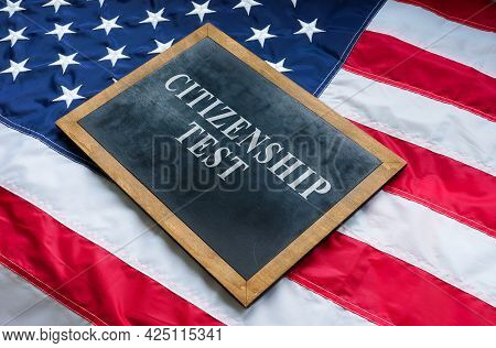 Citizenship Test On The Blackboard And Usa Flag.