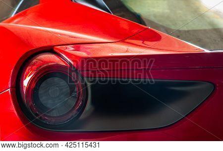 Bangkok, Thailand - 06 Jun 2021 : Close-up Of Rear Light Or Tail Lamp And Rim Of Red Ferrari Car. Fe