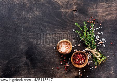 Food Cooking Background. Fresh Herbs Bunch Thyme And Condiments On Old Black Wooden Table. Thyme, Se