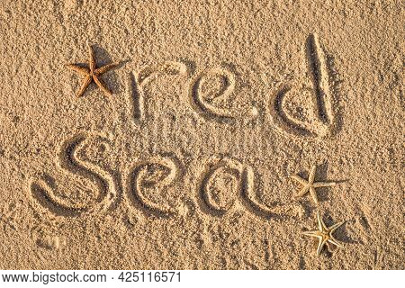 Vacation. Word Red Sea Written In The Sand On The Beach.vacation Holidays Background Wallpaper. Trav