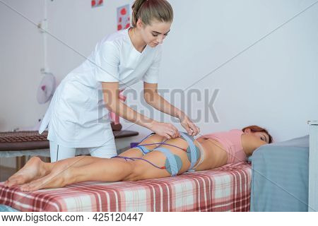 Miostimulation. Non-surgical Correction Of A Figure In A Beauty Salon. Anti-cellulite And Anti-fat H