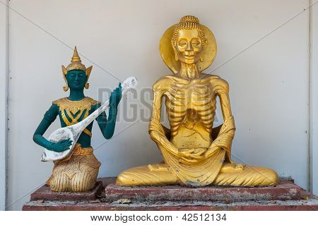Lord Buddha Doing Self Mortification And The God Playing Music To Relief His Stress