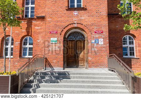 Szczecinek, Poland - May 31, 2021: Entrance To Town Hall At The Marketplace.