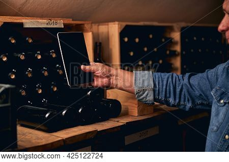 Taking Photos Of The Wine Bottles In Cellar