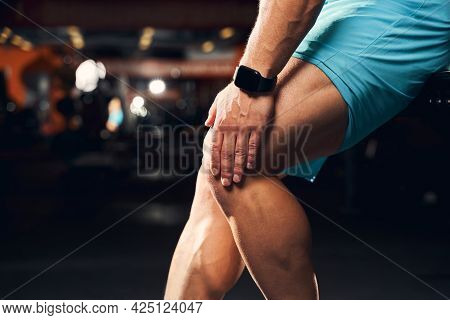 Tired Sportsman Experiencing Discomfort From Knee Pain