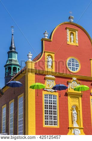 Colorful Umbrellas In Front Og The Gymnasialkirche Church In Meppen, Germany