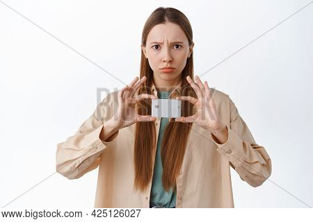 Disappointed Frowning Girl Sulking, Complaining On Bank, Showing Credit Card With Displeased Unfair