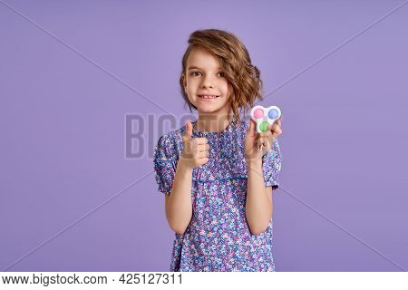 Picture Of Little Girl With A Modern Popit Toy. Colorful And Bright Pop It Toy Simple Dimple. Trendy