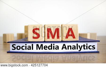 Sma Social Media Analytics Symbol. Wooden Cubes On Book With Word 'sma Social Media Analytics' On Be