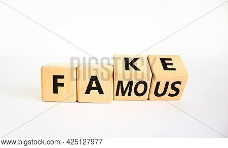 Fake Famous Symbol. Turned The Wooden Cube And Changed The Word Fake To Famous. Beautiful White Back