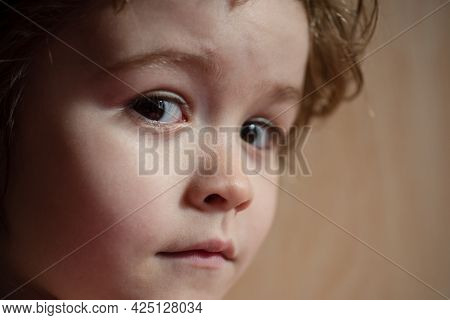 Portrait Of A Amazed Surprised Child Boy. Close Up Caucasian Kids Face. Closeup Head Of Funny Kid. B