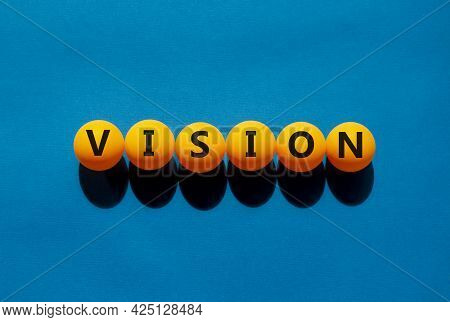 Vision And Business Symbol. The Concept Word 'vision' On Orange Table Tennis Balls On A Beautiful Bl