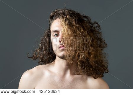 Man With Long Curly Hair, Haircut, Modern Hair Style. Close Up Portrait Of Male Model With Long Hair