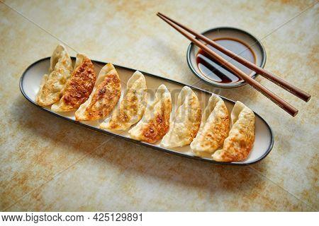 Orginal asian dumplings gyoza served in long plate