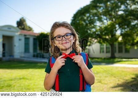 Back To School And Schooling. Little Schoolboy Pupil Back To School At Knowledge Day.