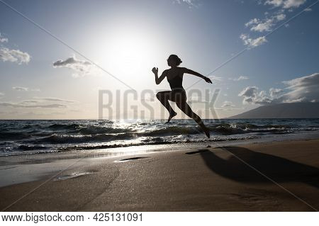Silhouette Of Runner Woman Exercising In Running Sprint Workout At Beach Jogging, Healthy Outdoors A