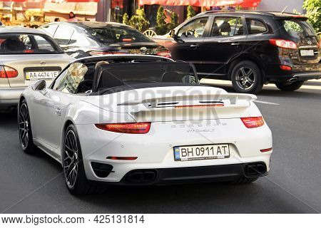 Kiev, Ukraine - May 22, 2021: White Supercar Porsche 911 Turbo S Cabriolet On The Road