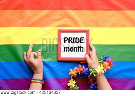 Text Pride Month. Simple, Minimal Lgbt Pride Decor. Hands With Rainbow Painted Nails With Wrist Band