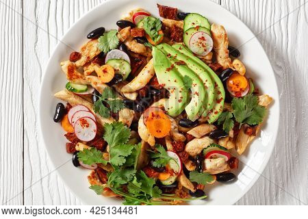 Mexican Salad Of Black Beans, Chicken Cilantro, Radish, Carrot, Cucumber And Avocado With Tahini Dre