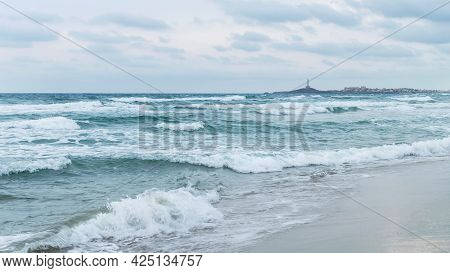 Stormy Mediterranean Sea And  Lighthouse In The Distance. Overcast In Mediterranean Sea, La Manga De