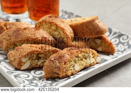 Tray With Tasty Cantucci And Glasses Of Liqueur On Light Table, Closeup. Traditional Italian Almond