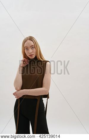 Seductive Young Caucasian Girl In Knitted Top Posing On Light Background And Looking At Camera, Vert