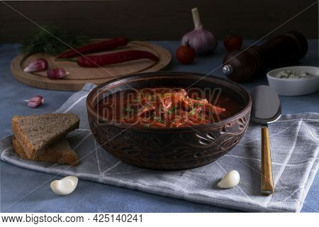 Close-up Of The Traditional Popular Russian Soup Borscht Made From Cabbage, Beets And Other Vegetabl