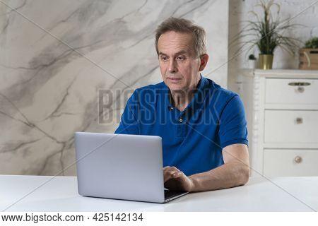 Portrait Of Surprised Shocked Amazed Man, Elderly Senior Male Is Working On Laptop, Having Problem W