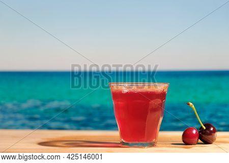 Alcoholic Drink In Beach Bar, Summer Sea Resort Concept. Glass Shot Of Cherry Liqueur.