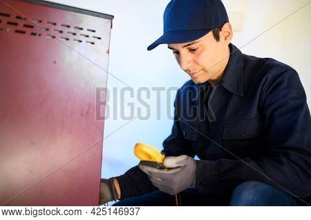 Technician maintaining a pellet stow heater