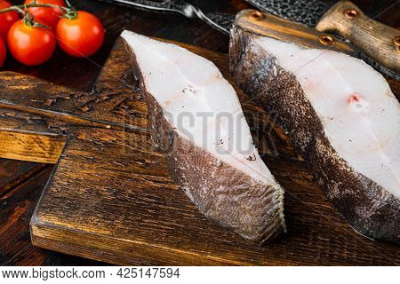 Piece Of Fresh Raw Halibut Fish Set, With Ingredients And Rosemary Herbs, On Old Dark  Wooden Table