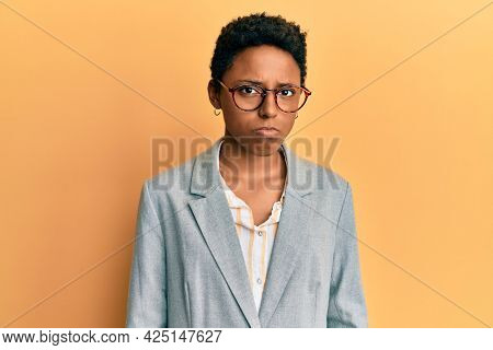 Young african american girl wearing business jacket and glasses depressed and worry for distress, crying angry and afraid. sad expression.