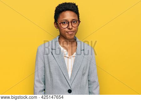 Young african american woman wearing business clothes looking sleepy and tired, exhausted for fatigue and hangover, lazy eyes in the morning.
