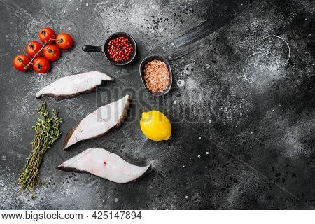 Sliced Halibut Fish Set, With Ingredients And Rosemary Herbs, On Black Dark Stone Table Background,