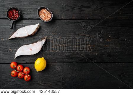 Sliced Halibut Fish Set, With Ingredients And Rosemary Herbs, On Black Wooden Table Background, Top