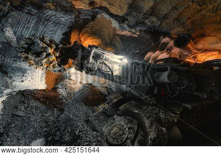 Underground Mining Of Ore. Drilling Head Of A Mine Roadheader.