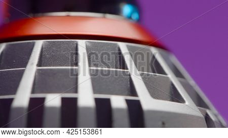 Close-up Of Details Of Light Bulb. Action. Holes And Details Of Modern Light Bulb On Isolated Backgr