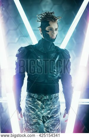 Warrior of the future. A brave cyberpunk warrior in protective uniform stands on alert in neon light. Game, virtual reality.